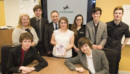 Lloyds Bank island director Peter Reid, standing, third from left, with Georgina Cooper, standing extreme left, and her daughter, Georgia holding trophy with Junior Achievement's Alex Day and Hilltop Hallucinations band members Antony Coward, Jordan Kirk, Luke Campbell, Niall McCabe-O'Kelly and Eddie Morris. Picture Andrew Barton.