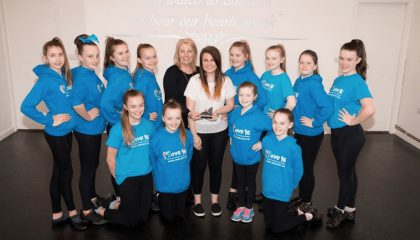 Pictured are members of Intensity Blue from Move It being presented with the award by members of Paul Cooper's family: his wife, Georgina and daughter, Georgia Cooper.
